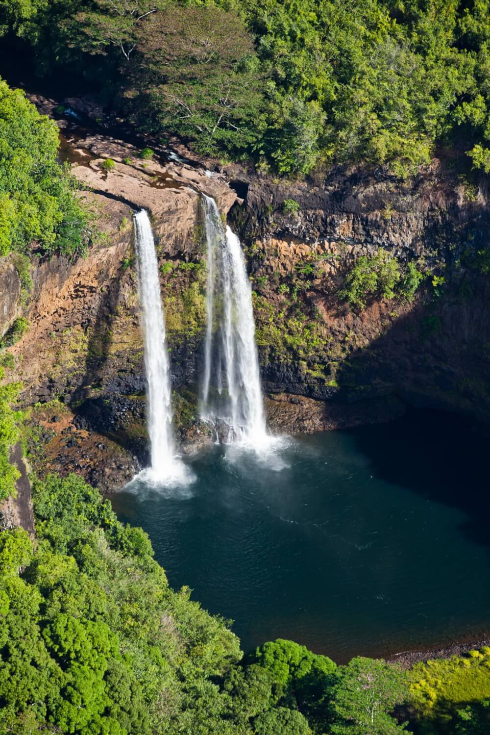 Find out the best Kauai waterfalls to visit with kids featured by top US travel blog, Hawaii Travel with Kids