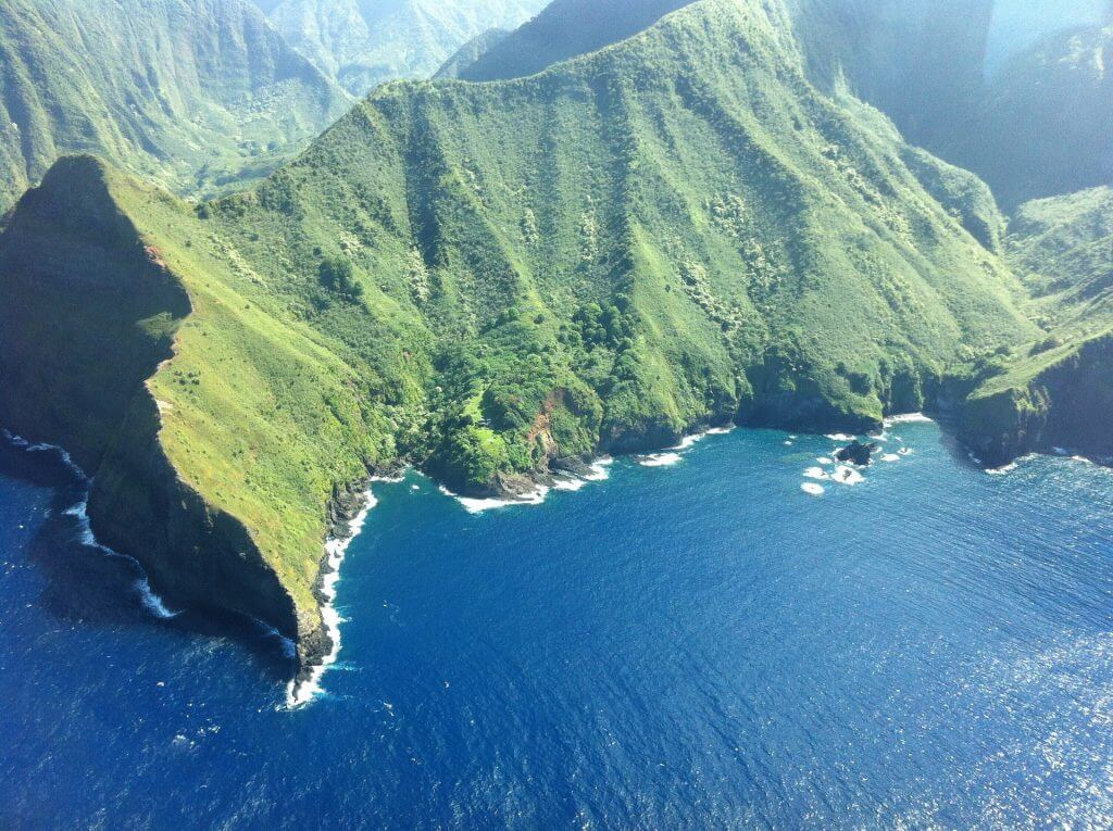 Should you plan a trip to Molokai for your first trip to Hawaii? Image of the coastline of Molokai in Hawaii.