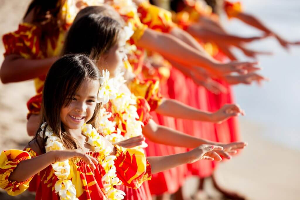 One of the best free things to do in Oahu with kids is see a hula show. Image of child hula performers.