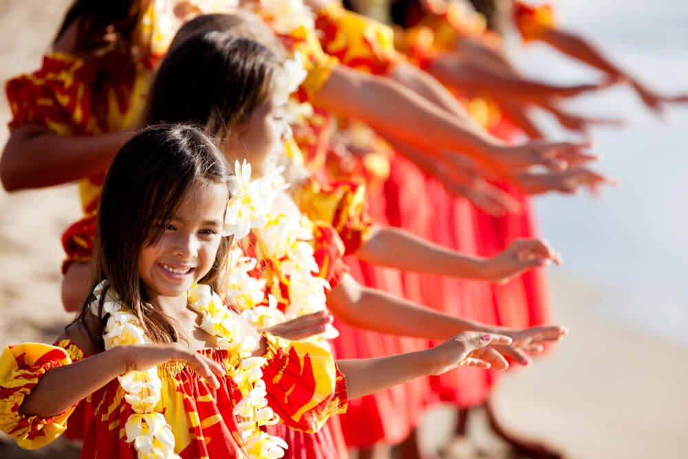 The Best 21 Free Things to do on Kauai with Kids featured by top Hawaii travel blog, Hawaii Travel with Kids: Hula girls on the beach