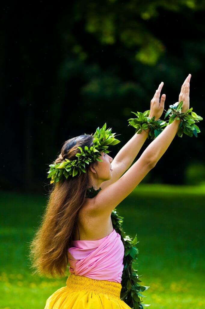 Another fun fact about Hawaii is that women weren't allowed to dance hula originally. Image of a woman hula dancing on Kauai.
