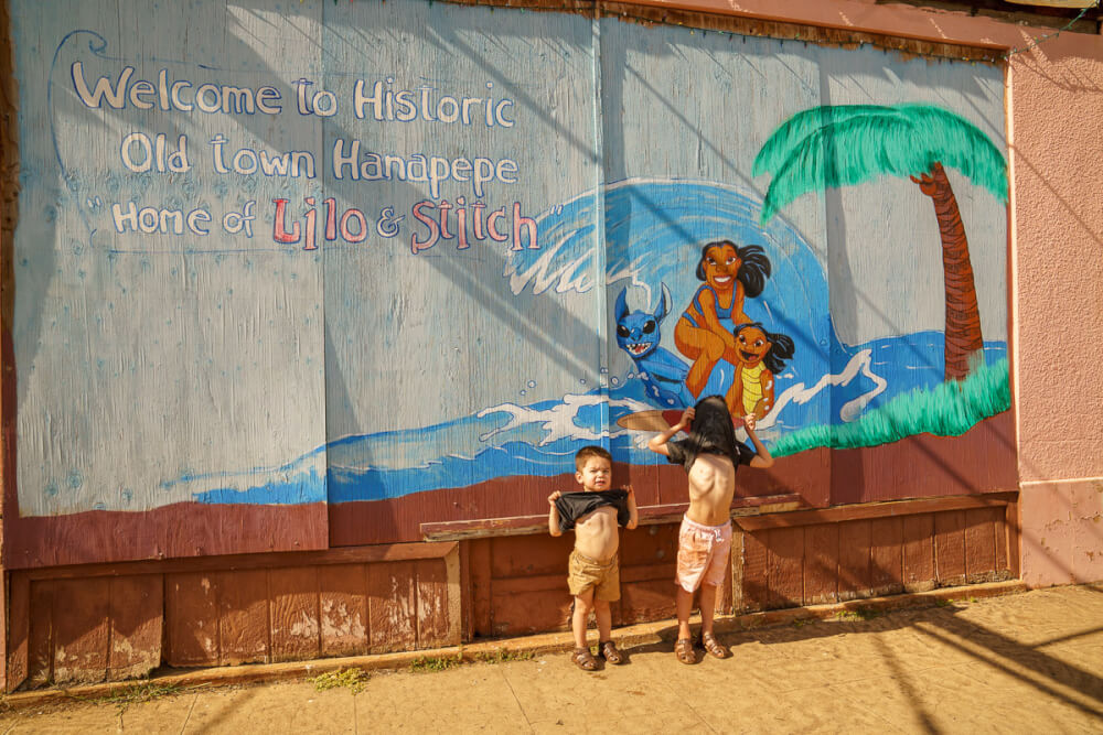 Oahu or Kauai: Which is the Best Hawaiian Island for Kids? Tips featured by top Hawaii travel blog, Hawaii Travel with Kids: Kids will love checking out all the art in Hanapepe, especially the Lilo & Stitch wall!