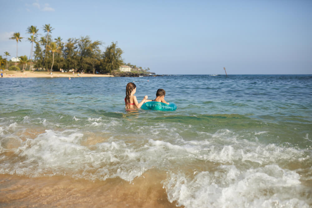 50 Best Places to Visit in Hawaii with your Family featured by top Hawaii blog, Hawaii Travel with Kids: Poipu Beach is a kid-friendly Kauai beach for families on the South Shore of Kauai