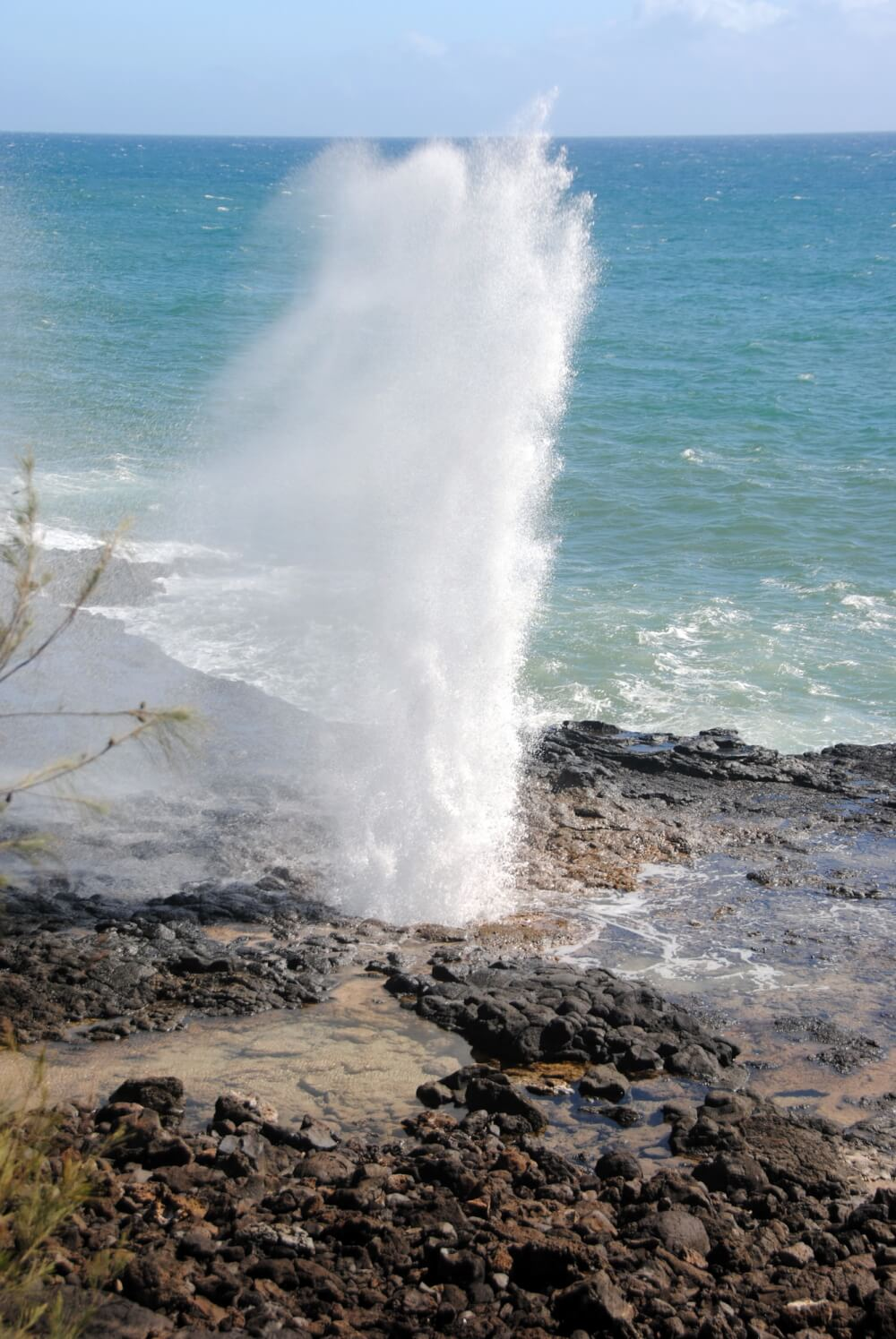 Oahu or Kauai: Which is the Best Hawaiian Island for Kids? Tips featured by top Hawaii travel blog, Hawaii Travel with Kids: Spouting Horn in Poipu is an awesome free thing to do on Kauai with kids