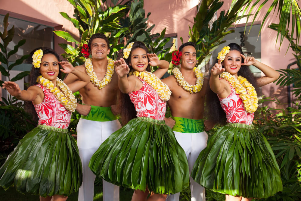 Hula dancers pose at the Aha Aina Luau on Oahu