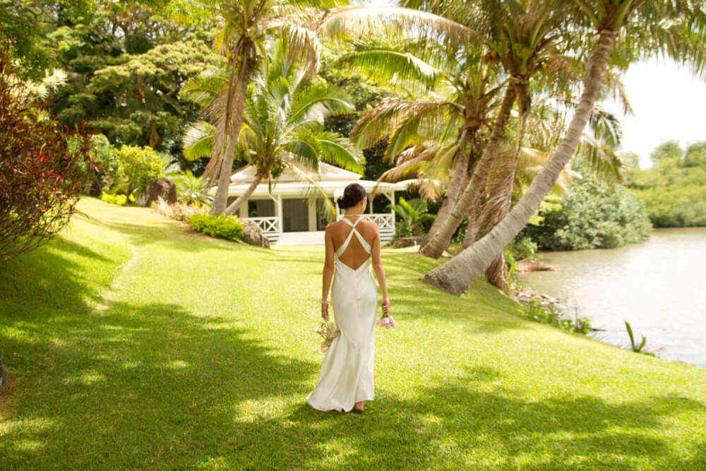 The Most Beautiful Places To Visit In Oahu featured by top Hawaii travel blog, Hawaii Travel with Kids: Kualoa Ranch is a popular Oahu wedding destination.