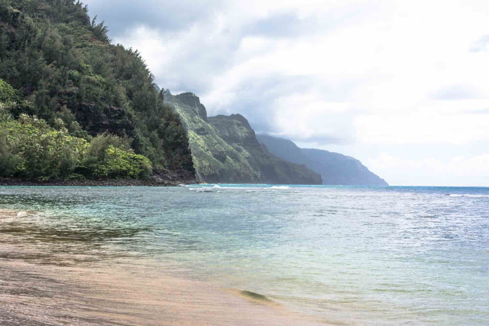 All the essential info on Kauai timeshares featured here on top Hawaii travel blog, Hawaii Travel with Kids: Kee Beach is a popular snorkeling Kauai beach at the end of the road on Kauai