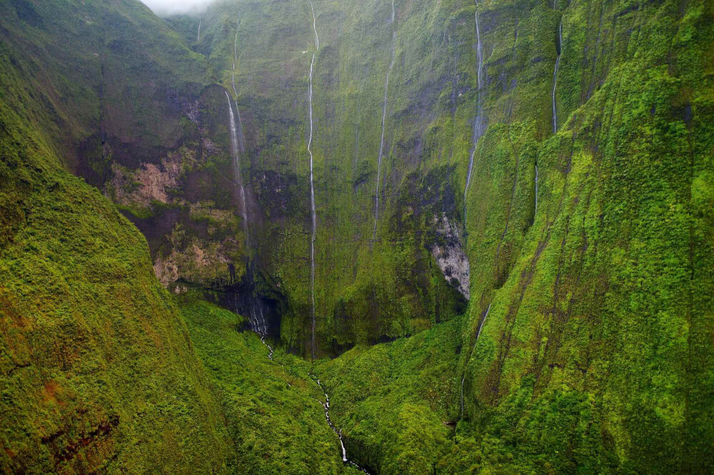 Top 11 Best Kauai Waterfalls you Should Visit featured by top Hawaii travel blog, Hawaii Travel with Kids: Mount Waialeale known as the wettest spot on Earth, Kauai, Hawaii