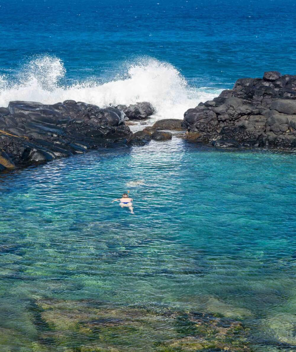 Top 9 Places for the Best Snorkeling on Kauai featured by top Hawaii travel blog, Hawaii Travel with Kids: Queen's Bath is a dangerous snorkeling Kauai spot in Princeville