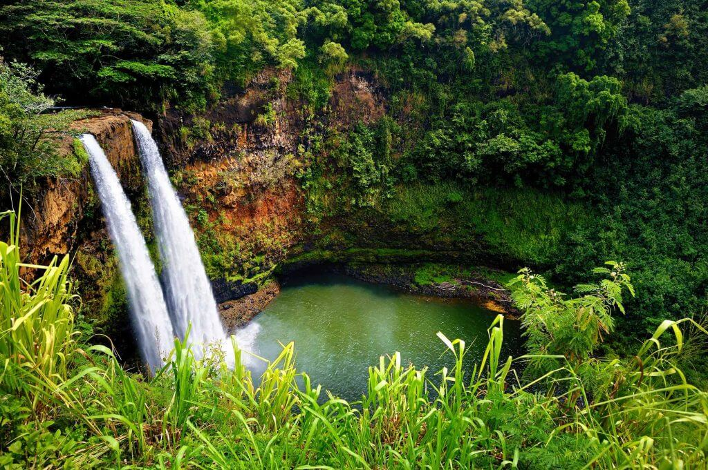 Find out kid-friendly things to do on Kauai featured by top Hawaii travel blog, Hawaii Travel with Kids: Wailua Falls is one of the best Kauai waterfalls and a top Kauai attraction
