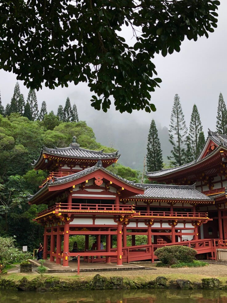 The Most Beautiful Places To Visit In Oahu featured by top Hawaii travel blog, Hawaii Travel with Kids: The Byodo-In Temple is a popular Oahu photography spot.