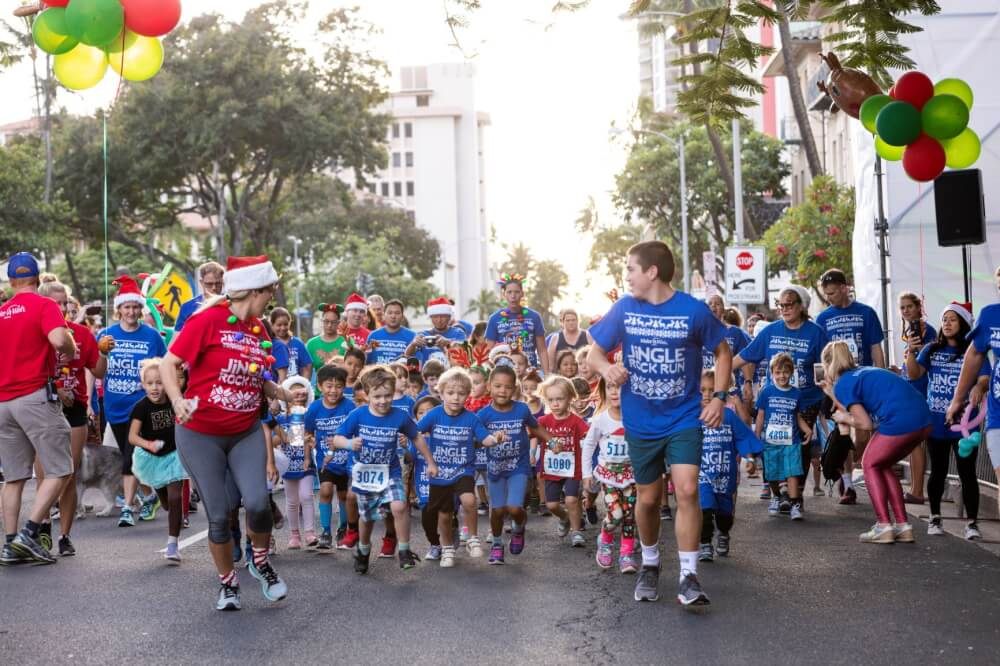 Holiday volunteer opportunities in Hawaii for families featured by top Hawaii blog, Hawaii Travel with Kids: Make A Wish Hawaii Jingle Rock Run