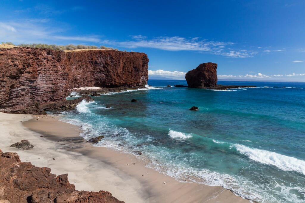 Should you visit Lanai when planning a Hawaii vacation? Image of the cliffs near Puu Pehe (Sweetheart Rock) on Lanai