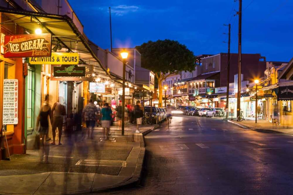 Things to do in Lahaina Maui featured by top Hawaii blog, Hawaii Travel with Kids: Front Street at nighttime, which is a vibrant part of Lahaina