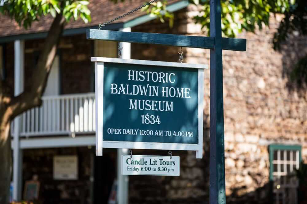 Things to do in Lahaina Maui featured by top Hawaii blog, Hawaii Travel with Kids: Sign outside the Historic Baldwin Home Museum, which is an interesting thing to do in Lahaina, Maui