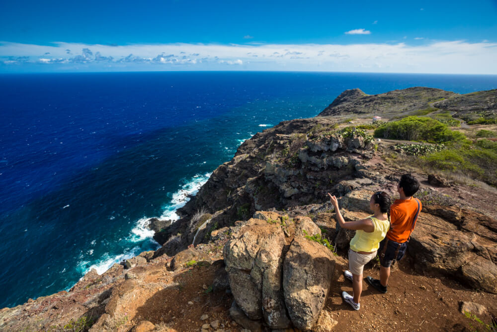 6 Easy Hikes on Oahu for Families featured by top Hawaii blog, Hawaii Travel with Kids: Couple look across the Pacific from Makapuu Trail