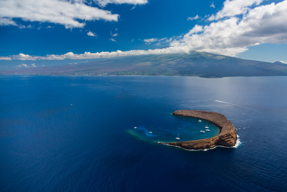 Best Snorkeling in Maui featured by top Hawaii blog, Hawaii Travel with Kids: Molokini Crater, Maui snorkeling spot