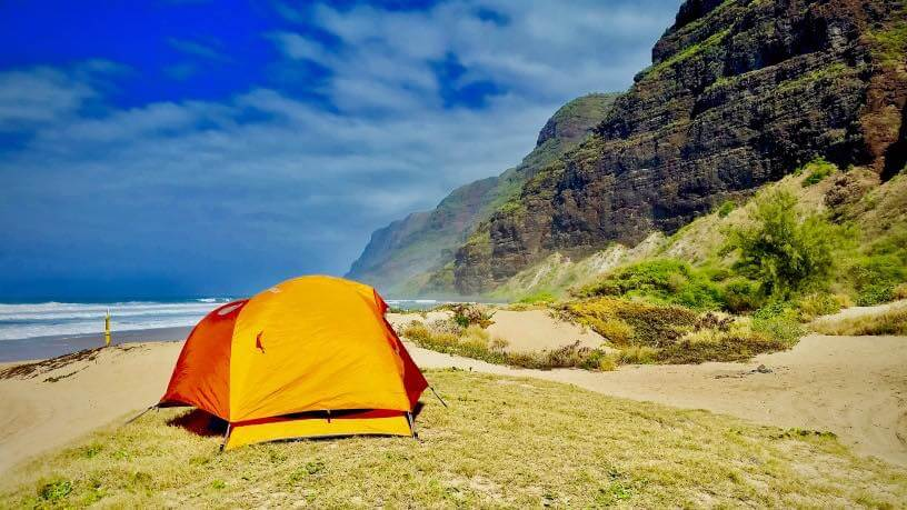 Guide to Camping in Hawaii featured by top Hawaii blog, Hawaii Travel with Kids.   Camping in Hawaii can be really cheap, if you know where to stay, like at the Na Pali Coast on Kauai