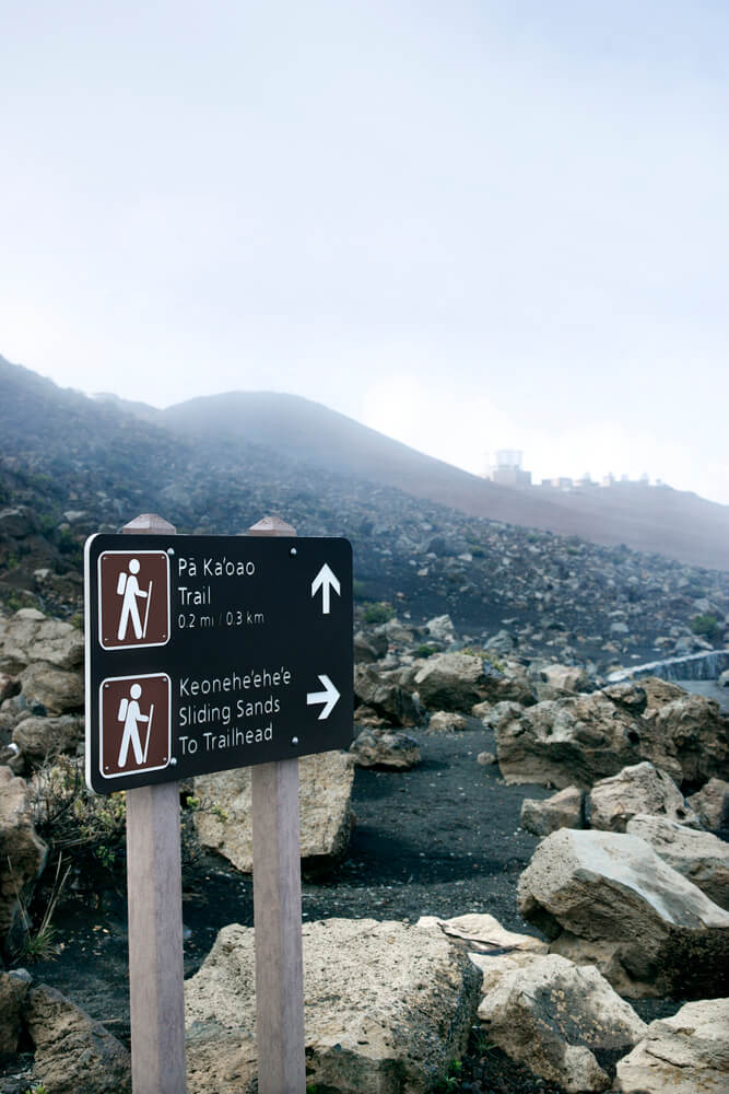 The Best Maui Hiking Trails featured by top Hawaii blog, Hawaii Travel with Kids: Trail sign at the Haleakala National Park for Sliding Sands hike on Maui