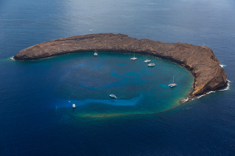 Exploring Molokini Crater in Maui, a guide featured by top Hawaii blog, Hawaii Travel with Kids.
