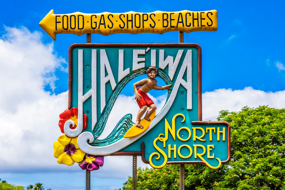 Best things to do in haleiwa oahu, featured by top Hawaii blog, Hawaii Travel with Kids: Road sign for the town of Haleiwa famed as a surfing mecca on the North Shore of the Hawaiian island of Oahu, USA