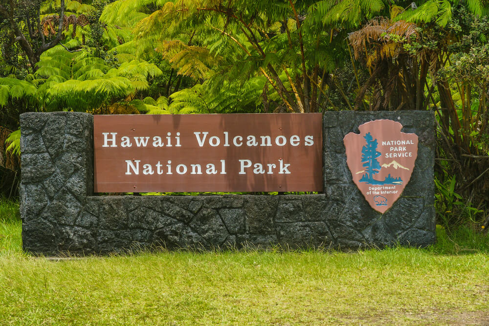 The Ultimate Guide to Hawaii Volcanoes National Park featured by top Hawaii blog, Hawaii Travel with Kids: Entrance Sign in Hawaii Volcanoes National Park in Hawaii.