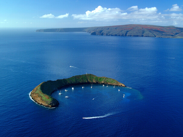 50 Best Places to Visit in Hawaii with your Family featured by top Hawaii blog, Hawaii Travel with Kids: Exploring Molokini Crater in Maui, a guide featured by top Hawaii blog, Hawaii Travel with Kids.