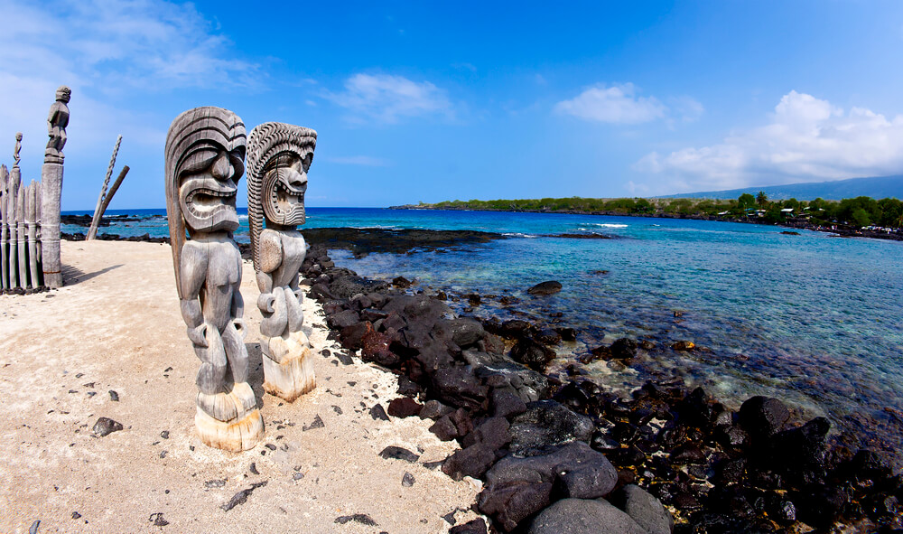 50 Best Places to Visit in Hawaii with your Family featured by top Hawaii blog, Hawaii Travel with Kids: Wide Angle Tikis at Place of Refuge (Pu'uhonua o Honaunau National Historical Park) in Kona Hawaii