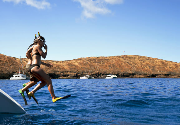 Exploring Molokini Crater in Maui, a guide featured by top Hawaii blog, Hawaii Travel with Kids: Snorkelers at Molokini Crater near Maui