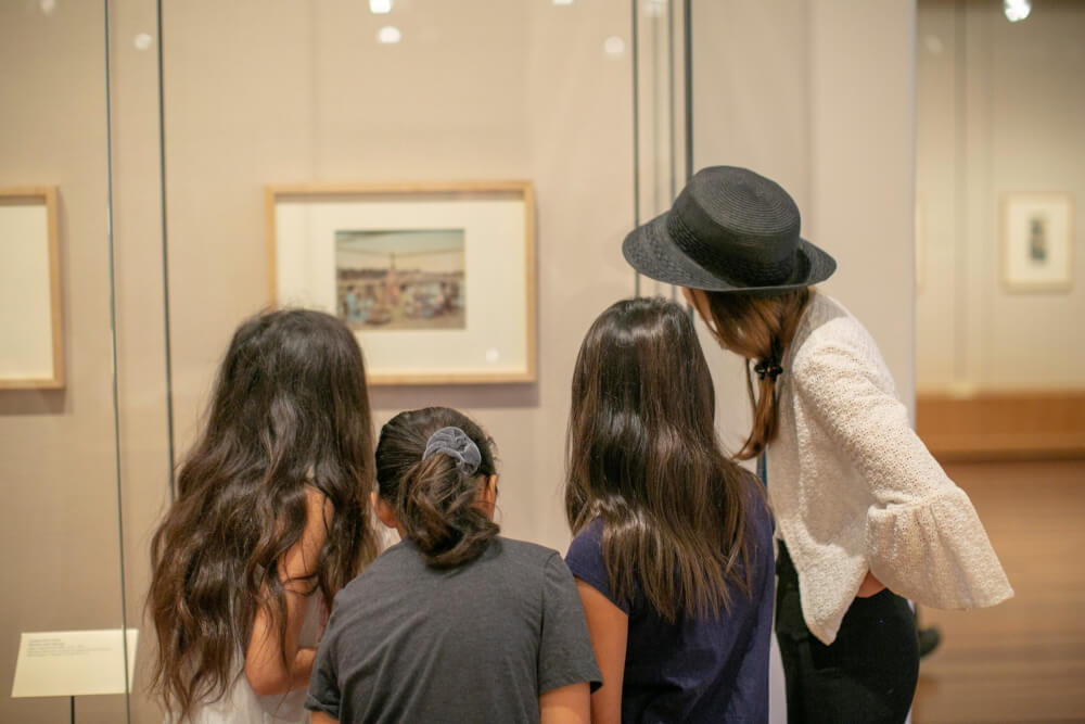 Things to Do in Hawaii with Kids: a review of Honolulu Museum of Art on Oahu featured by top Hawaii blog, Hawaii Travel with Kids: image of Kids looking at artwork at the Honolulu Museum of Art on Oahu
