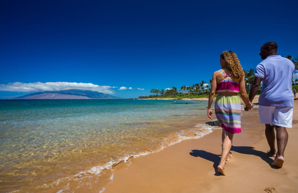 21 Best Things to Do in Wailea Maui featured by top Hawaii blog, Hawaii Travel with Kids: A couple walking on the beach in Wailea, Maui