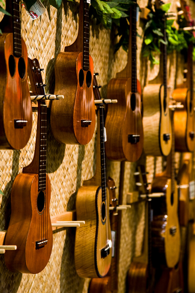 Top 13 Best Hawaiian Souvenirs to Bring Home featured by top US Hawaii blog, Hawaii Travel with Kids: Hawaiian ukuleles