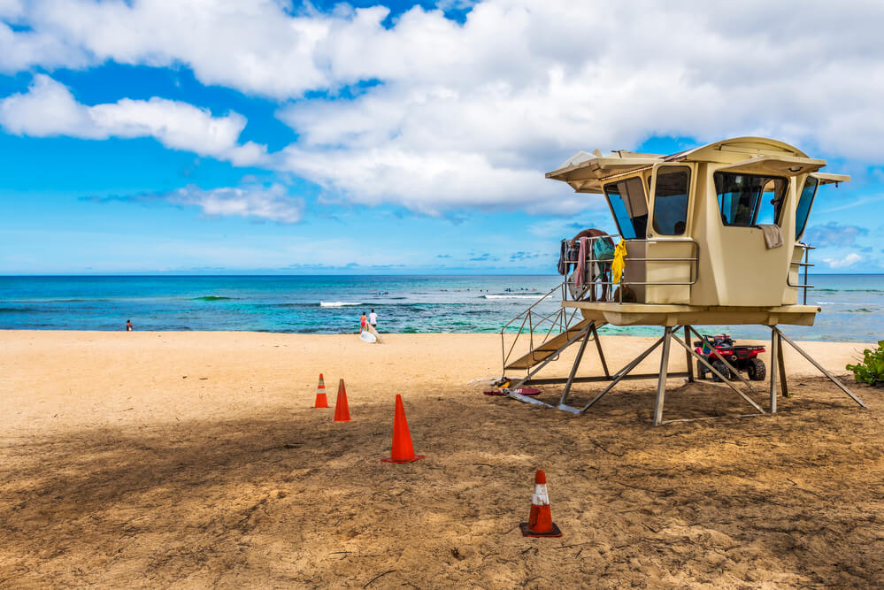Oahu Surfing On The North Shore, a complete guide featured by top Hawaii blog, Hawaii Travel with Kids: Life guard tower at Laniakea beach in North Shore Oahu.