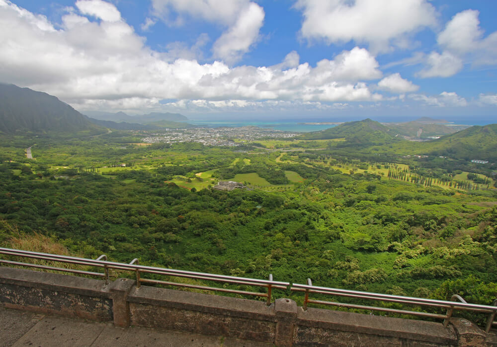 17 Historical Places in Hawaii to Visit with Kids featured by top Hawaii blog, Hawaii Travel with Kids: View of the windward coastline of Oahu, Hawaii, from the Nuuanu Pali Lookout in the mountains above Honolulu