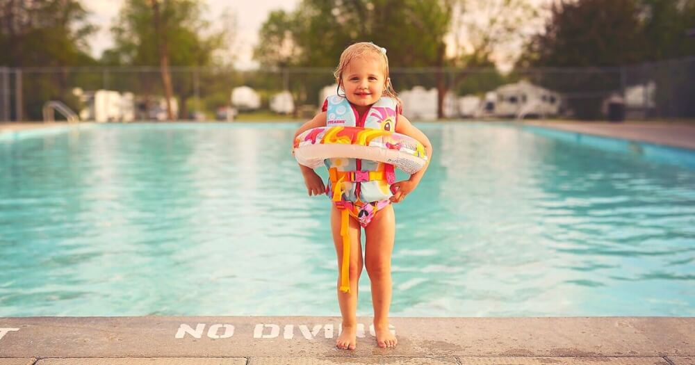 Child at the poool wearing one of the best life jackets for toddlers to stay safe and have fun