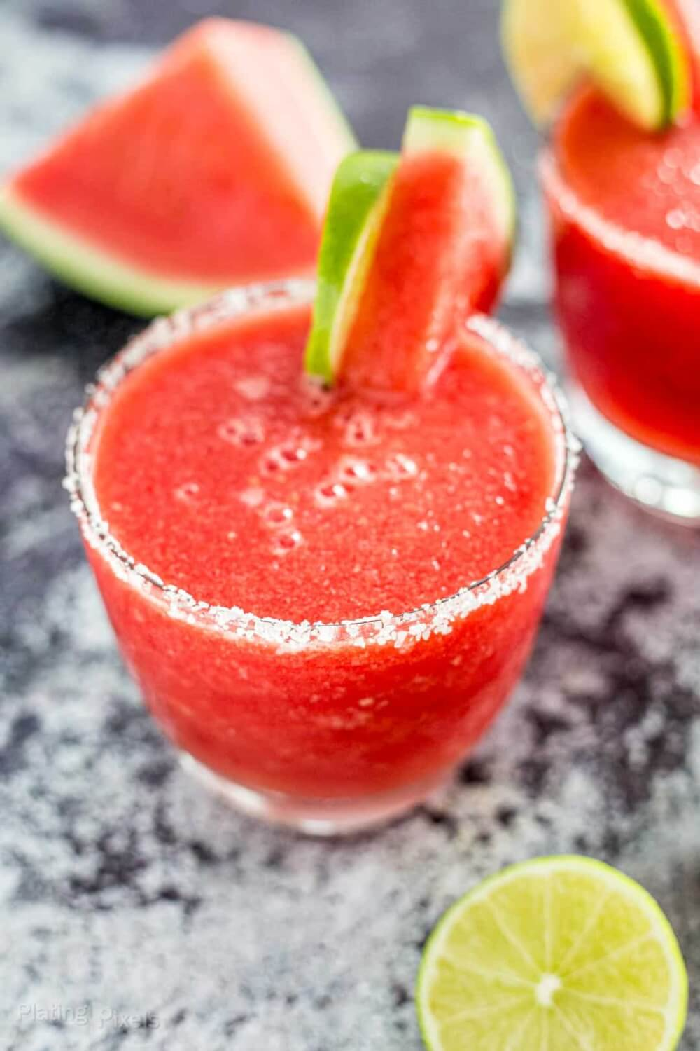 40 Hawaiian Cocktails To Try At Home featured by top Hawaii blog, Hawaii Travel with Kids: Close up shot of a Frozen Watermelon Margarita