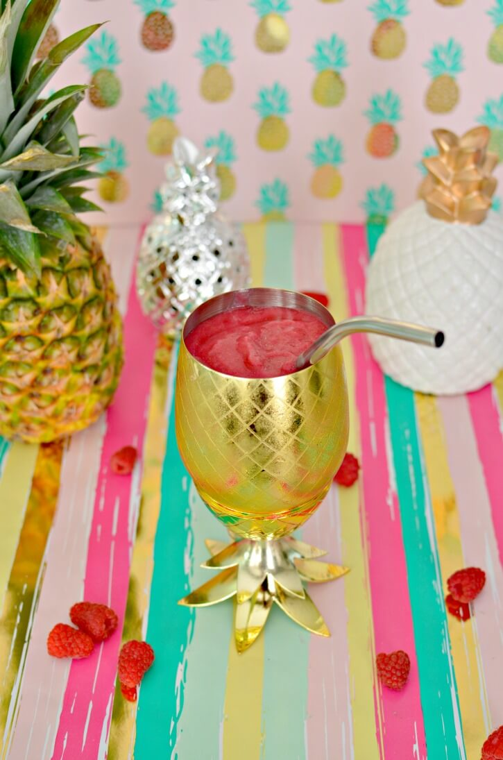40 Hawaiian Cocktails To Try At Home featured by top Hawaii blog, Hawaii Travel with Kids: Pineapple Raspberry Slushie Cocktail