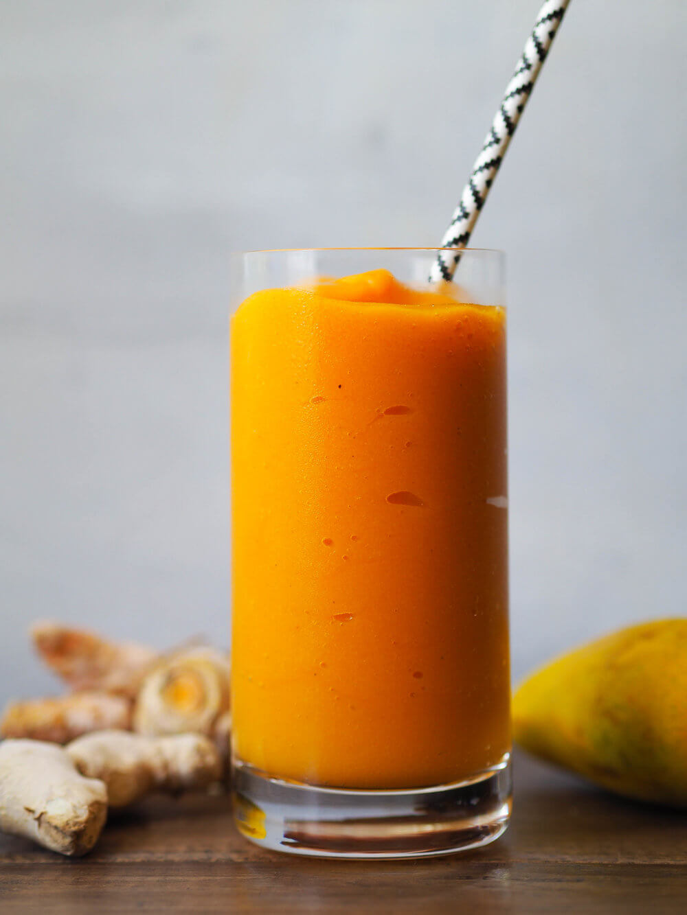 Hawaiian Tropical Smoothie Recipes to Make at Home featured by top Hawaii blog, Hawaii Travel with Kids: This turmeric mango smoothie is creamy and refreshing! Blended with coconut water so it's extra hydrating! #summer #smoothie #mango #turmeric #healthyrecipe #vegan #vegetarian