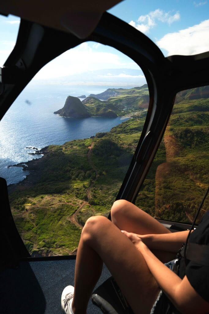 A Complete Travel Guide to Maui with Kids featured by top Hawaii travel blog, Hawaii Travel with Kids: Photo of a helicopter ride from Maui to Molokai #helicopter #hawaii #maui #molokai