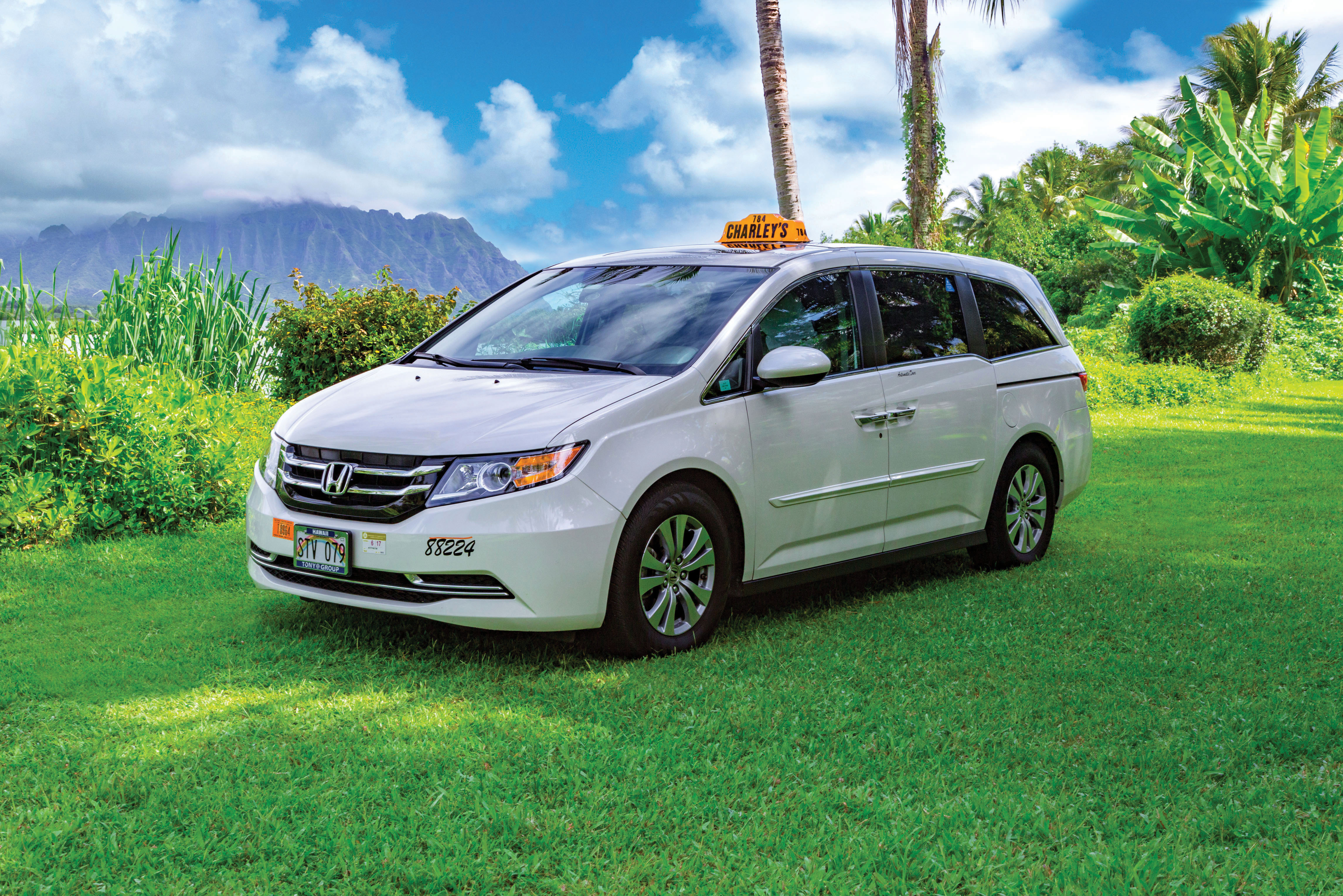 How to Get from Honolulu Airport to Waikiki Easily, tips featured by top Hawaii blog, Hawaii Travel with Kids: https://hawaiitravelwithkids.com/wp-content/uploads/2020/05/Charleys-Taxi-Honda-Odyssey-w-o-driver_160809-170_RGB.jpg