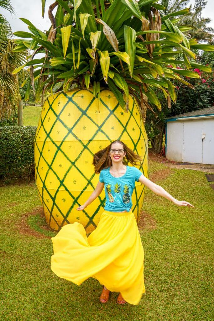 Top 12 Best Photo Opportunities on Kauai featured by top Hawaii travel blog, Hawaii Travel with Kids: One of the best photo opportunities on Kauai is this giant pineapple roadside attraction at the Kauai Trading Post in Lawai.
