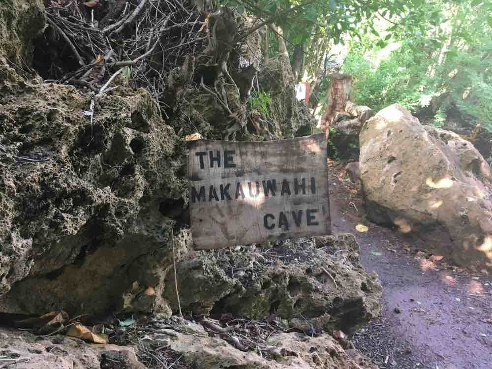 Top 25 Things to do in Poipu, Kauai featured by top Hawaii blog, Hawaii Travel with Kids: The Makauwahi Cave Sign in Poipu Kauai