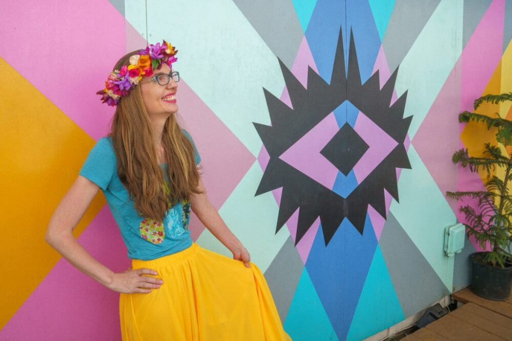 Top 12 Best Photo Opportunities on Kauai featured by top Hawaii travel blog, Hawaii Travel with Kids: This colorful mural is a secrety photo spot on Kauai and is perfect for the Kauai Instagrammable shot!