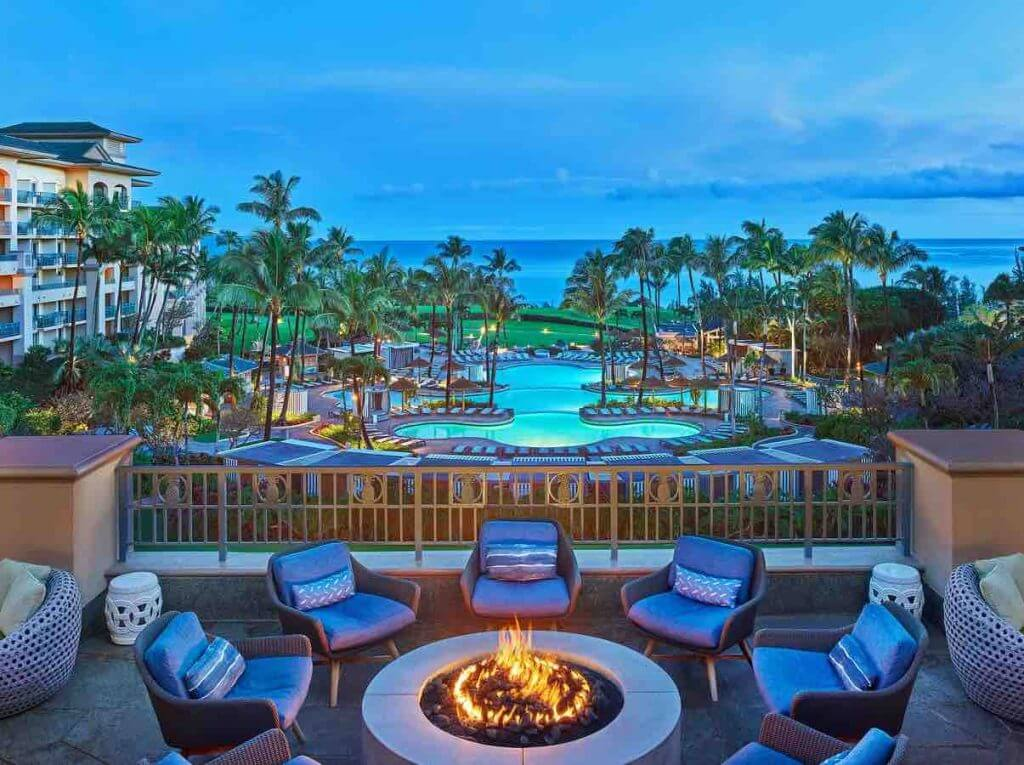 Where do celebrities stay in Hawaii? The Ritz Carlton is a top Maui luxury hotel. Image of the fire pit at the Ritz-Carlton Kapalua Maui resort