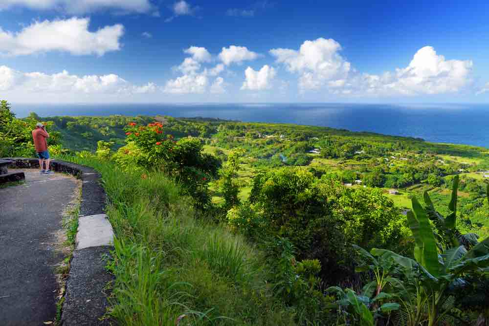 Road to Hana Guide: 15 Things to Know Before You Drive the Road to Hana featured by top Hawaii blog, Hawaii Travel with Kids: Beautiful views of Maui North coast seen from famous winding Road to Hana. Hawaii, USA.