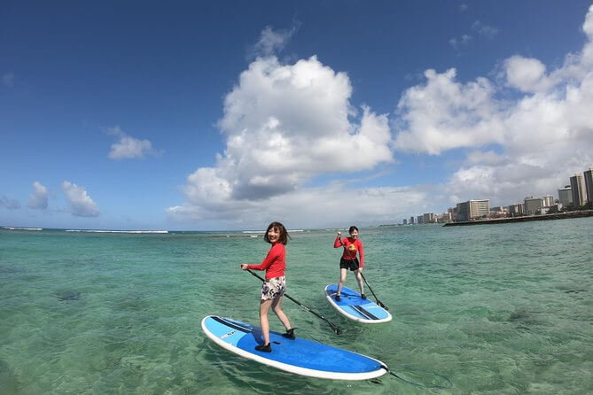 25 Amazing activities in Waikiki with kids featured by top Hawaii blog, Hawaii Travel with Kids: Stand Up Paddleboarding in Waikiki