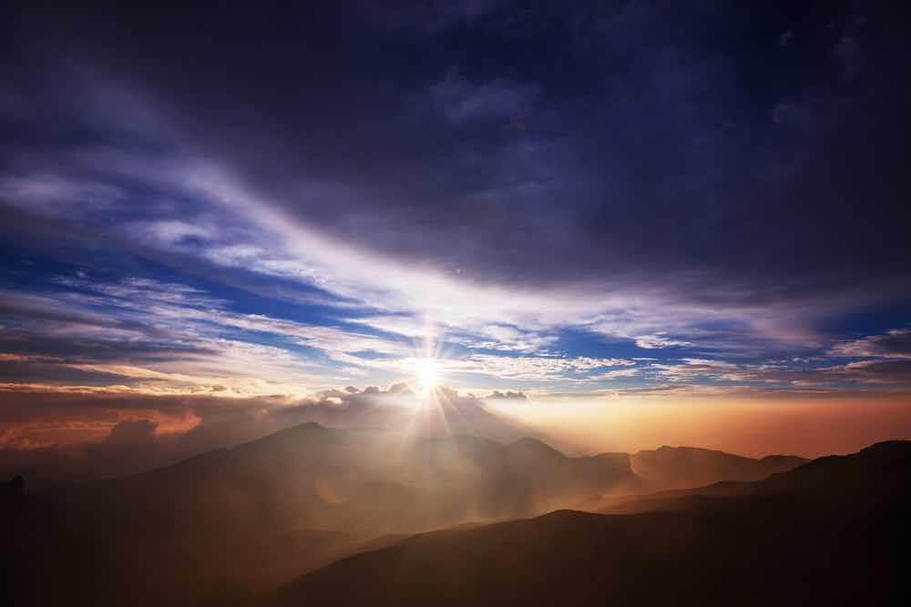 Be sure to check out Haleakala as you're planning a trip to Maui. Image of a beautiful sunrise scene on Haleakala volcano, Maui island, Hawaii