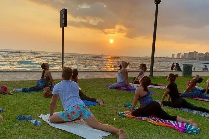 25 Amazing activities in Waikiki with kids featured by top Hawaii blog, Hawaii Travel with Kids: Sunset Yoga Class in Waikiki.