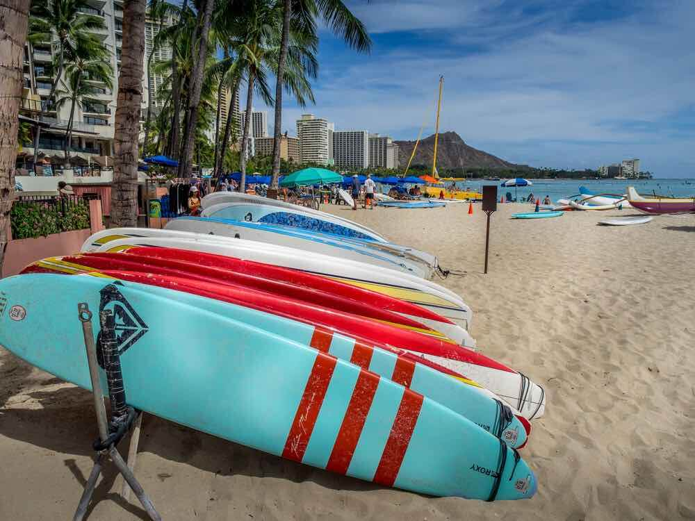 Fun things to do in Oahu with toddlers by top Hawaii blog, Hawaii Travel with Kids: Surfboards on Waikiki Beach with view of Diamond Head