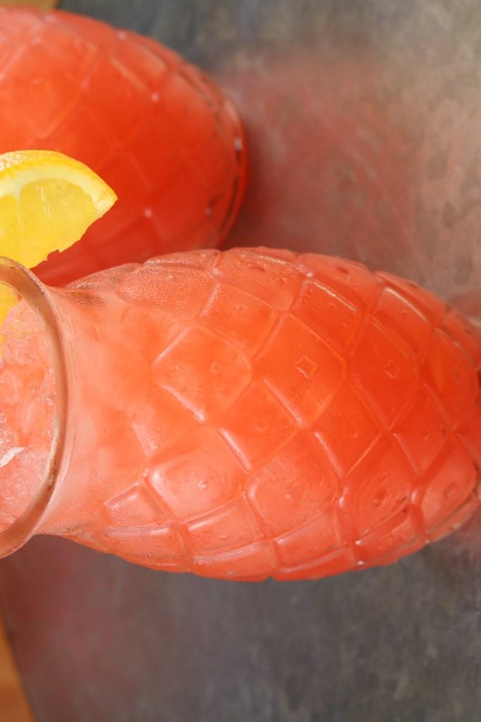 Vodka Party Punch garnished with an orange slice